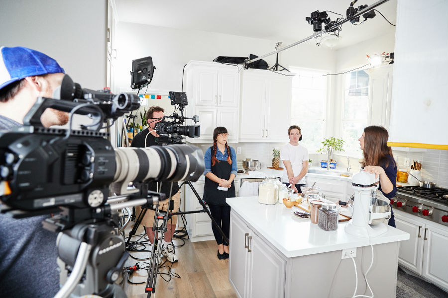 Cast and crew in the Spoiled To Perfection kitchen