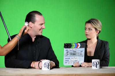Brian and Emily in front of green screen