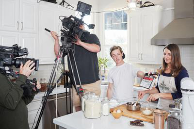 Crew filming Joanna cooking