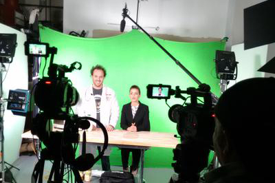 Emily and Brian in front of green screen