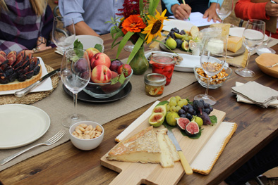 Spread of fruit and cheese on table