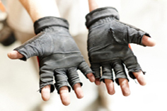 crew member wearing gloves with cutoff fingers.