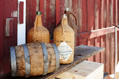 wicker wrapped jugs on shelf