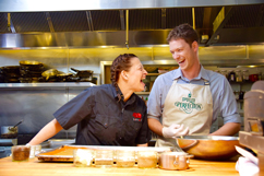 Duskie Estes and Garrett Martin in the kitchen at Zazu Kitchen
